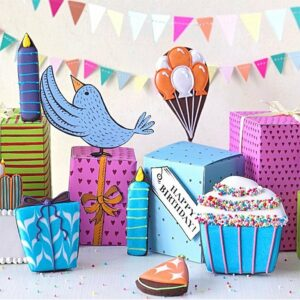 A picture of colourful iced biscuits in cake & bird shapes